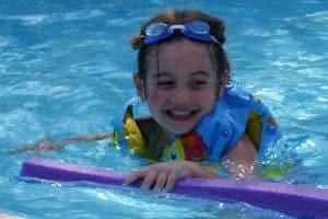 Young child swimming in a pool